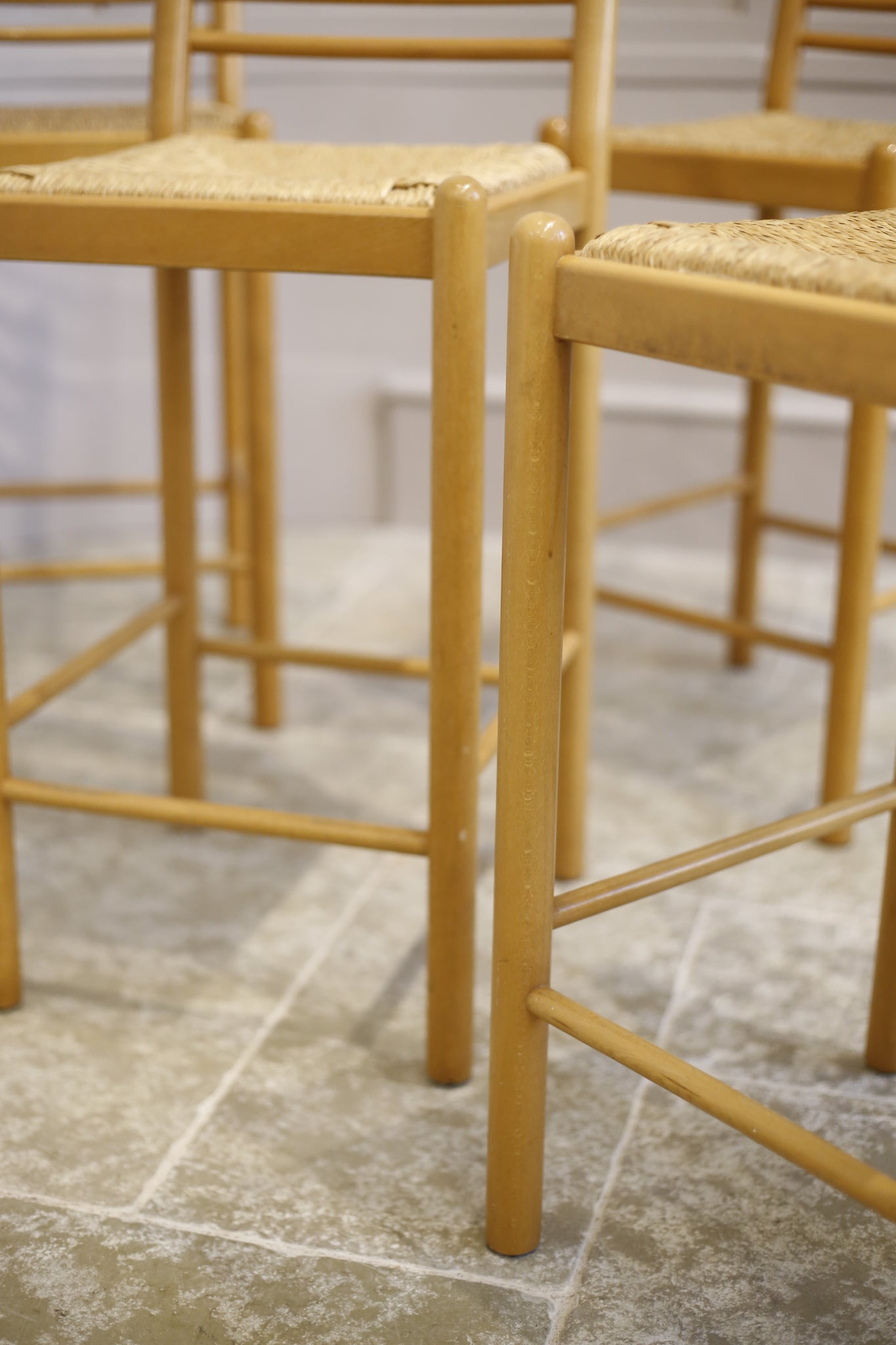 4x Mid century blonde wood and rush seated bar stools