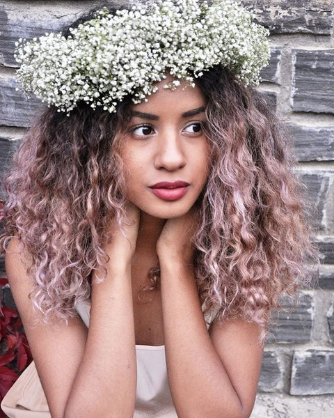 Baby's breath hair wreath on curly hair