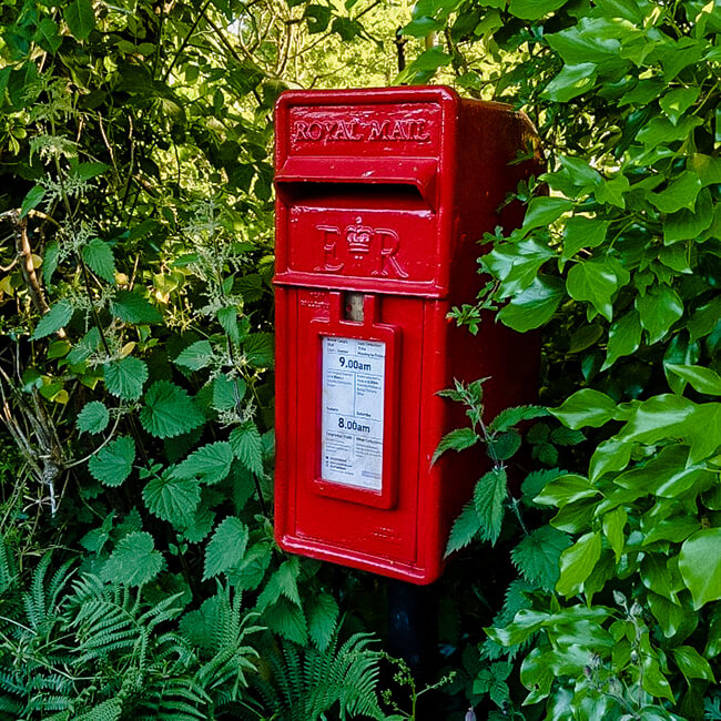 Royal Mail red postbox for sending birthday cards