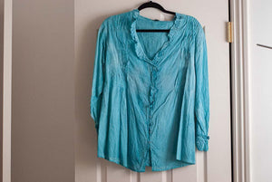 Turquoise  blue Boho style top with elastic waist in back.