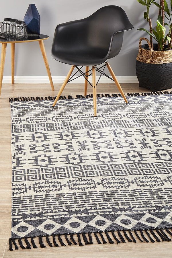 Zulu Totemic Flock Black Rug - Block & Crate
