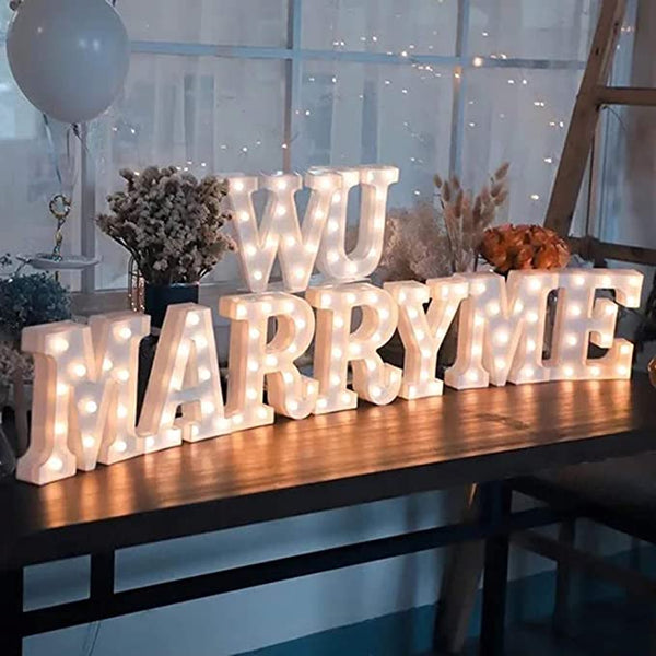 Marquee letters 'W U MARRY ME' lights
