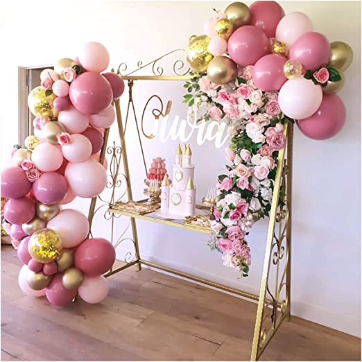 golden cake stand with pink balloons