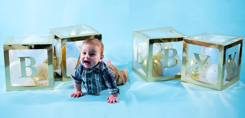 Baby boy with Gold BABY boxes