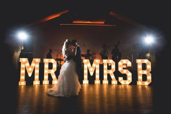 Groom & Bride with the marquee letter lights