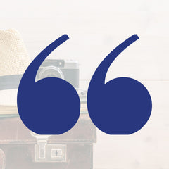 Travel gear and quotation marks for Easier Journeys' favorite travel quotes blog post.