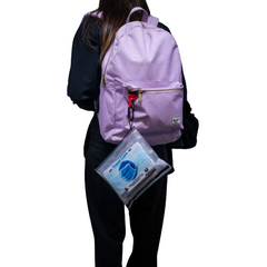 Image of Easier Journeys travel and on-the-go care kit, woman has it attached to her backpack for safe journeys walking, hiking, road tripping.