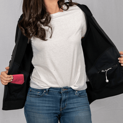 Woman showcasing Easier Journey's hidden pockets hoodie. On-the-go gear. Crossbody bags, fanny packs, hoodies and scarves.
