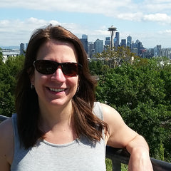 Easier Journeys Owner - Raelyn Anderson - at Kerry Park in Seattle with Space Needle in background