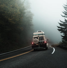 """Van heading off on a foggy road trip. """"Difficult roads often lead to beautifuly destinations"""" travel quote. Easier Journeys."""