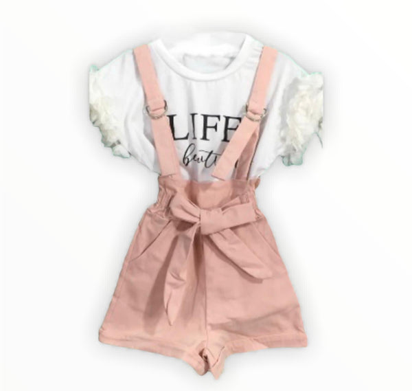White ruffle slogan top and pink dungarees