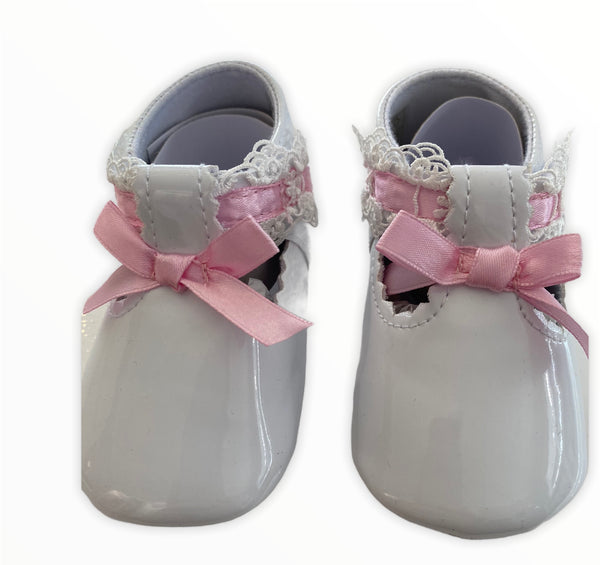 White with pink bow sevva shoes