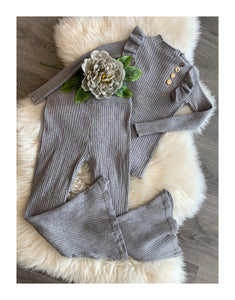 Grey flared pants and top with gold buttons