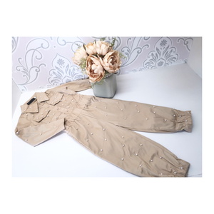 Beige boiler suit with pearl detail