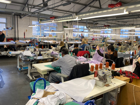 Apparel Tasker machinists sewing on the production line, overlooking the cutting table.