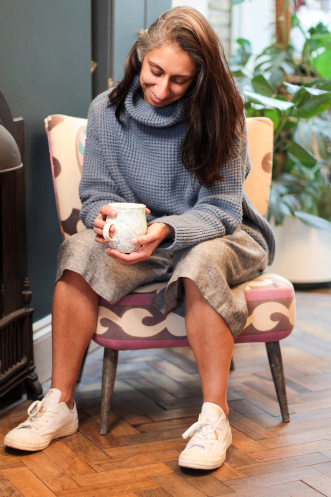 Saywood Social Club - Make with Mandi at home sitting with a cup of tea wearing the Bolt Culottes and blue sweater