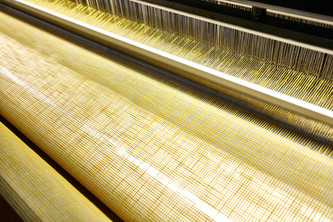Fabric in the Process of Being Woven on the Weaving Machine