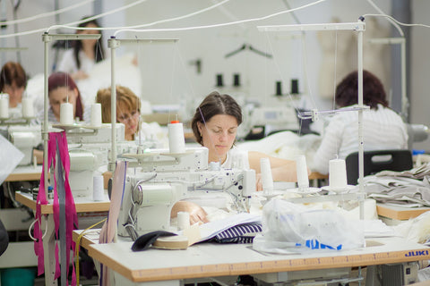 Saywood Blog - Ethical garment manufacturer Mantra machinists sewing the garments on the production line.