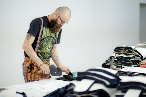 Saywood Blog - Mantra garment manufacturer labelling up the size panels for each of the garments.