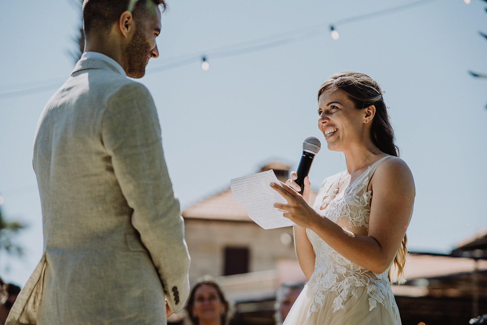 Bride and Groom make their vows in their pre-loved wedding outfits