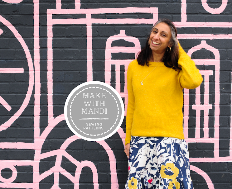 Saywood Social Club with home sewing Make With Mandi - Mandi is wearing a yellow jumper and floral skirt with hand on head standing in front of a pink and grey patterned wall, with Make With Mandi logo in centre of image.