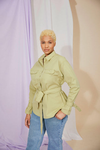Womens Shirt Zadie Boyfriend Shirt in olive green, worn with jeans by model, with hand in her pocket and tied belt round waist.