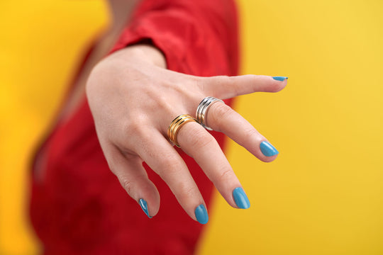 Handcrafted, contemporary design silver and gold rings