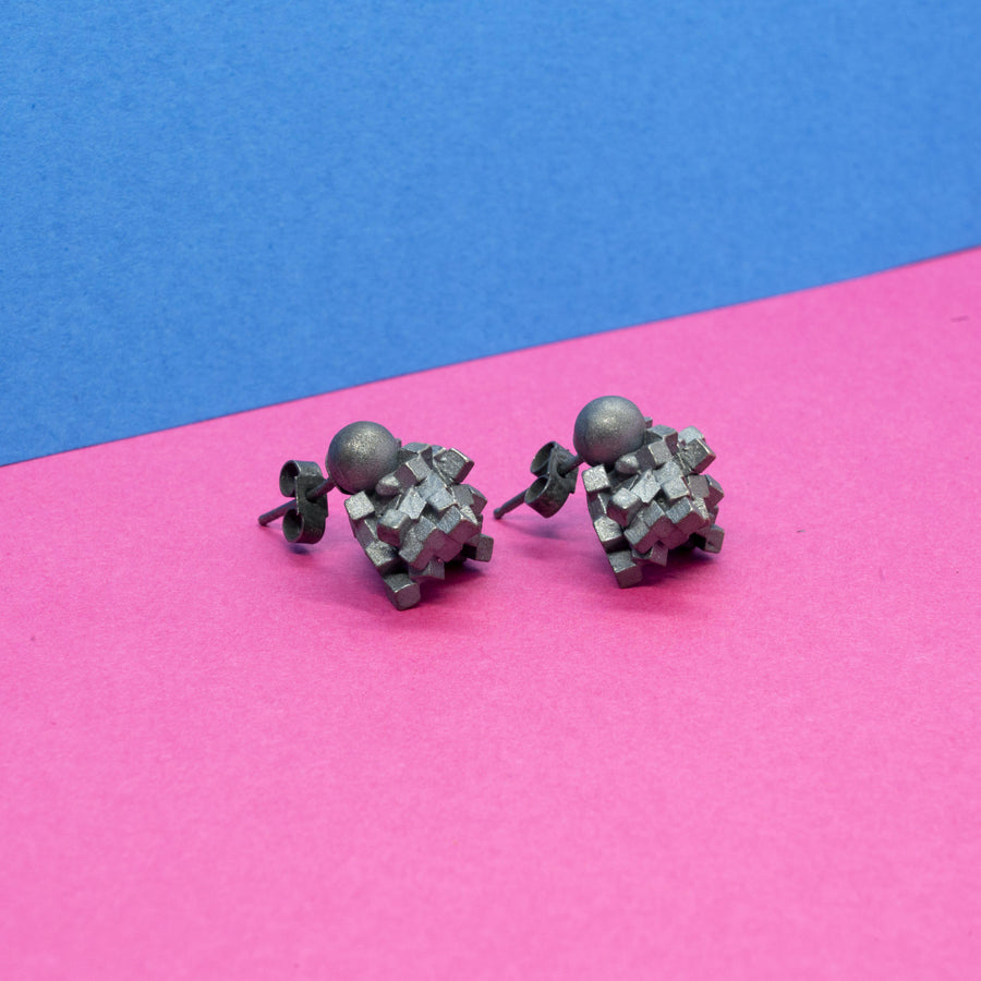 Cluster Earrings-The Adversity Collection continues with these stud earrings. They are designed to sit just against the earlobe and as each earring is uniquely made, there is some subtle diversity on where the sphere finally sits. The cluster measures approx 1.2cm in diameter. Available in gold or silver and a variety of finishes, prices start at €275 for gold plate with a pin polished finish; €275 for gold plate matt finish; approx €950 for solid 9ct gold in either a pin polish or golden sand f