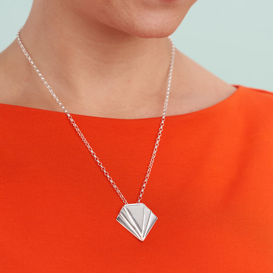 Coming Together Pendant-A contemporary twist on the art deco style, this bold statement pendant necklace will perfectly compliment any outfit. The pendant measures just under 3cm square (slightly longer than it is wide) anchored on a silver chain. This pendant necklace is a perfect choice when accessorising a symmetrical fashion style. Available in sterling silver, dipped gold, 9ct or 18ct gold. As the market price of gold varies, please DM for today's price with no obligation to purchase.-Vanes
