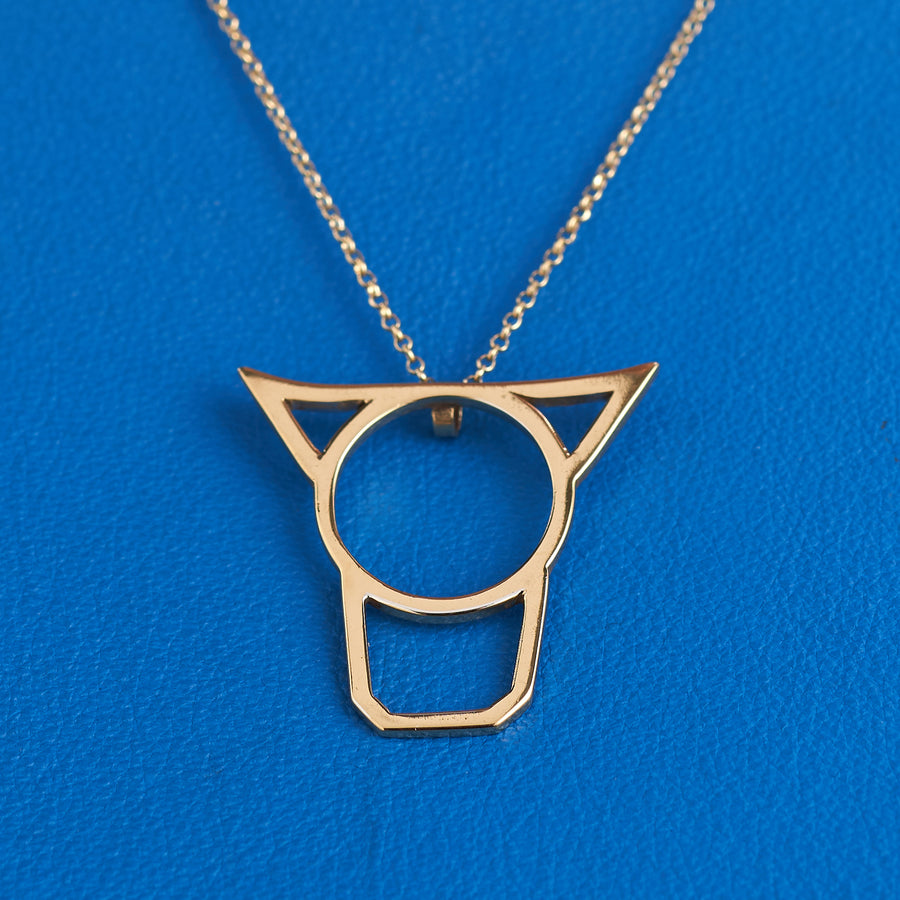 Cow's Head Pendant-The third member of the Irish Animal collection, the Cow's Head is wonderfully symmetrical. The simple shapes are super as a pendant hanging below the throat. This piece is available in sterling silver, gold plate or 9ct gold, and is 3cm tall and 3cm wide at its widest point. It is only available as a pendant and comes on an 18