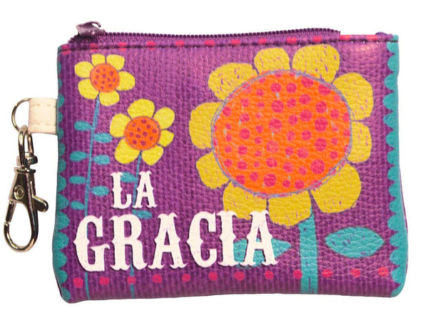"Coin purse is 3"" x 4"" with colored zipper, key, and lobster clasp. Carry your change in style in these clip-on coin purses. A convenient accessory to keep loose change all together and brighten up your day. Front and back features full color print. Features Spanish inspirational phrase. Material: PU."