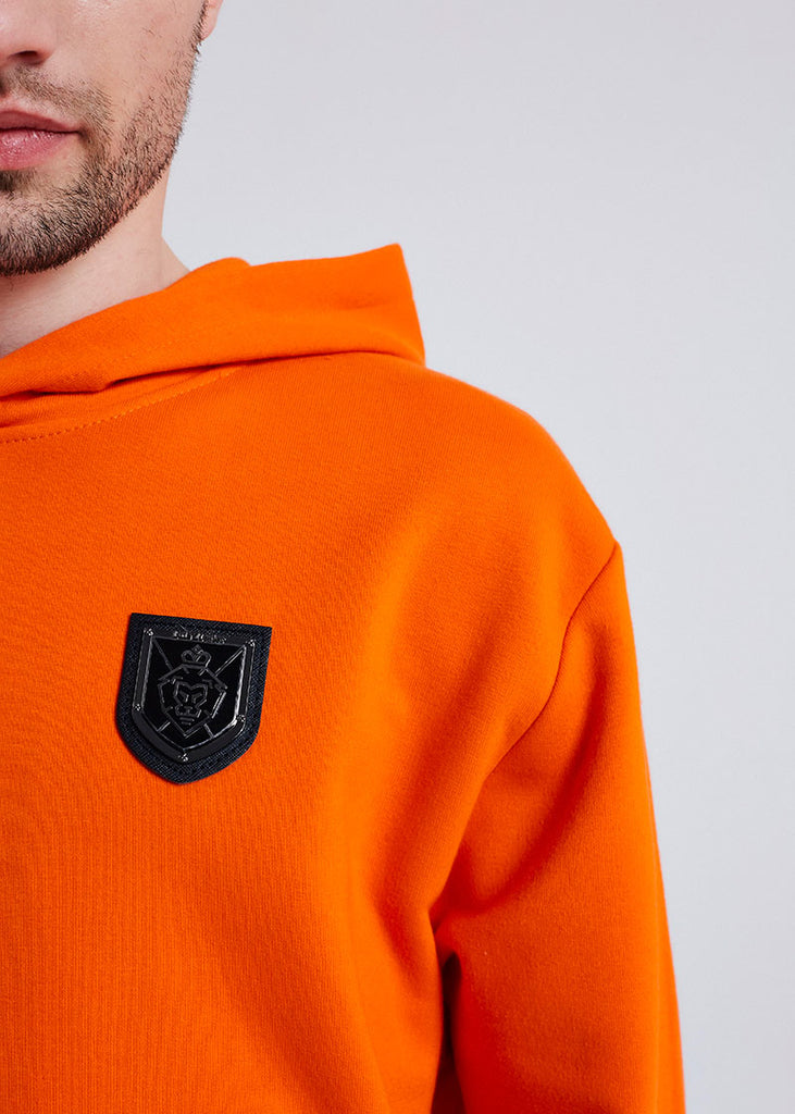 MEN ORANGE METAL BADGE HOODIE