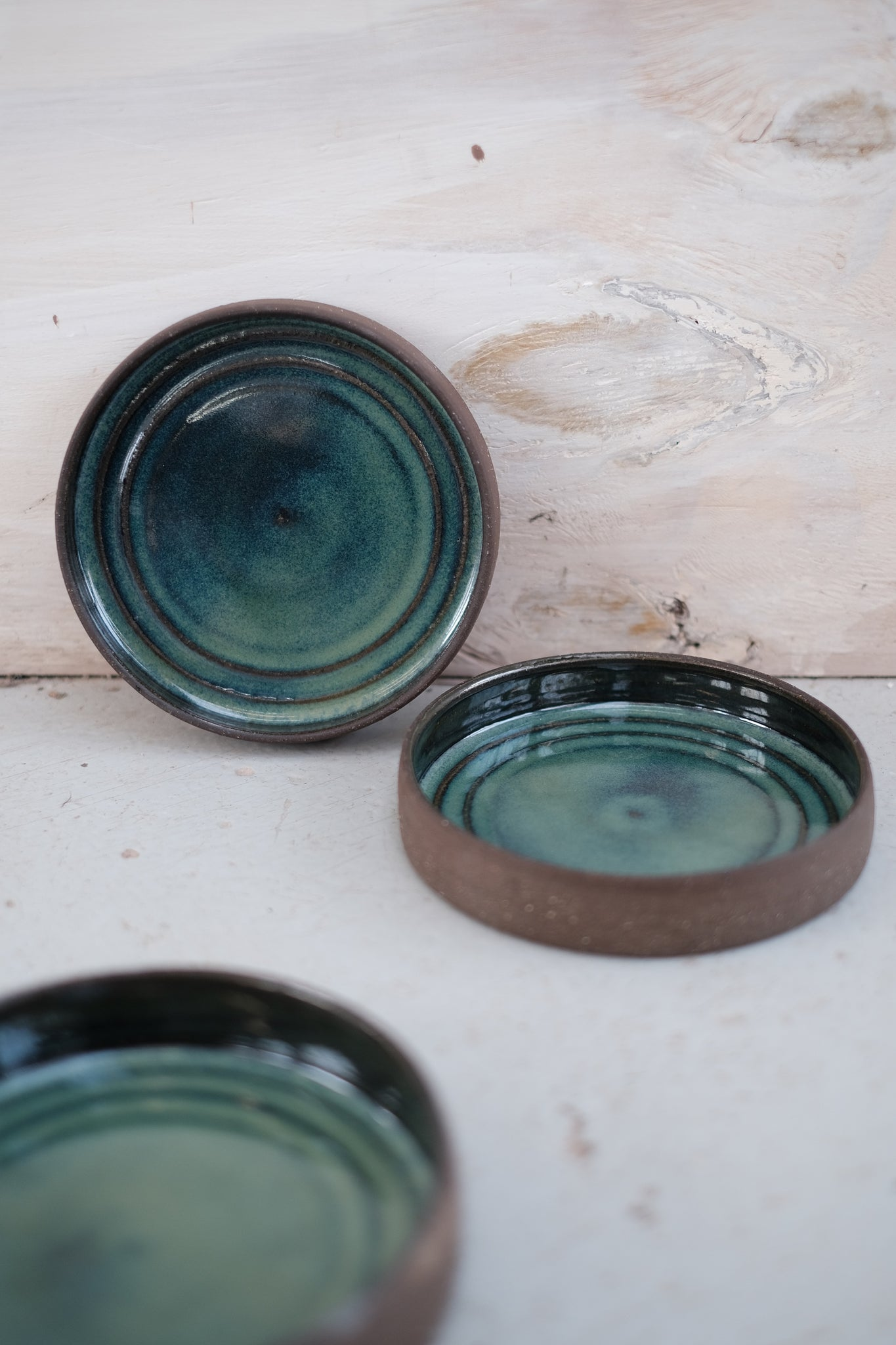 Candle plates in blue green glaze