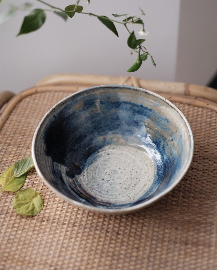 extra large white ceramic bowl decorated on the inside with a blue brush stroke