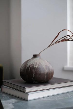 pumpkin shaped decorative vase in earthy tones