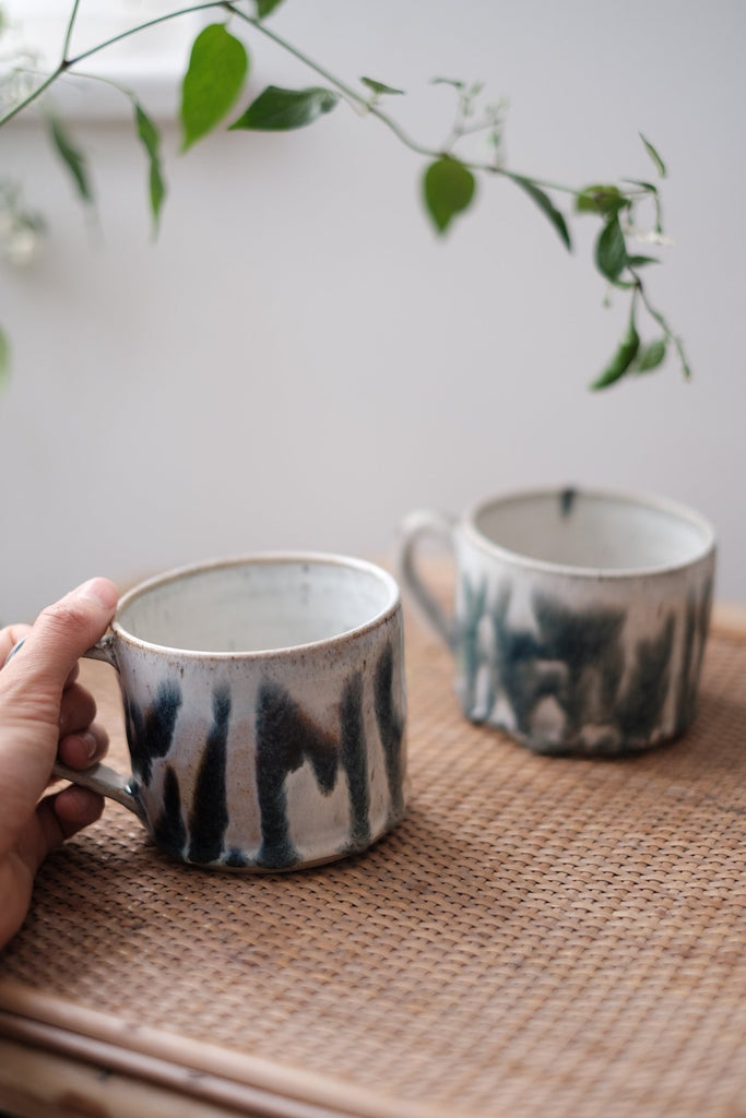 white ceramic mugs with blue ripple decoration