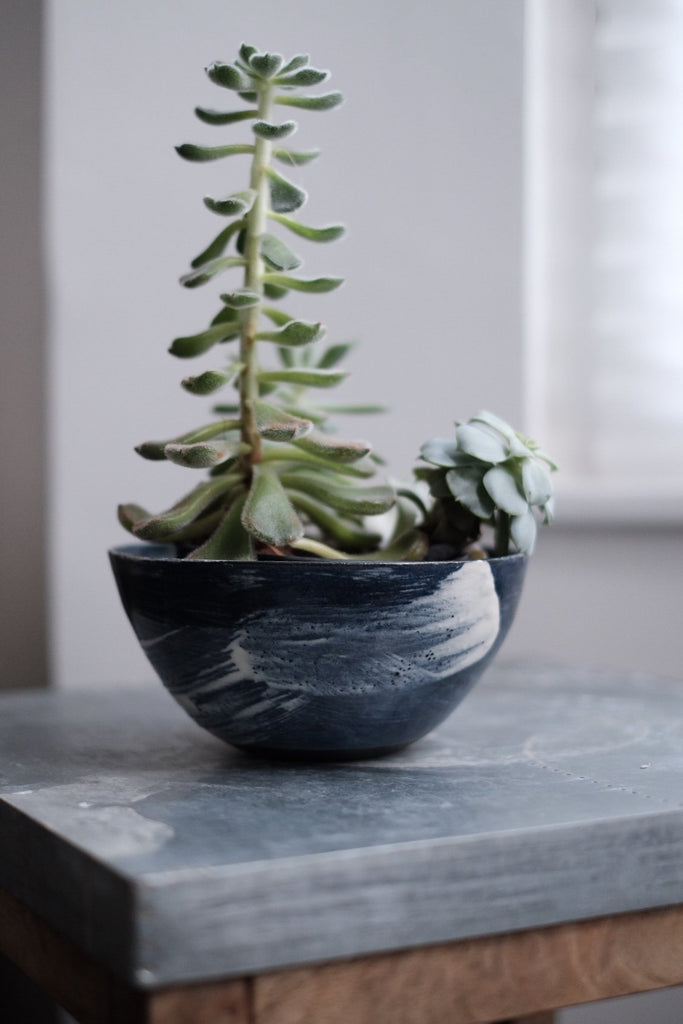 blue ceramic bowl shaped planters with white brush stroke decoration