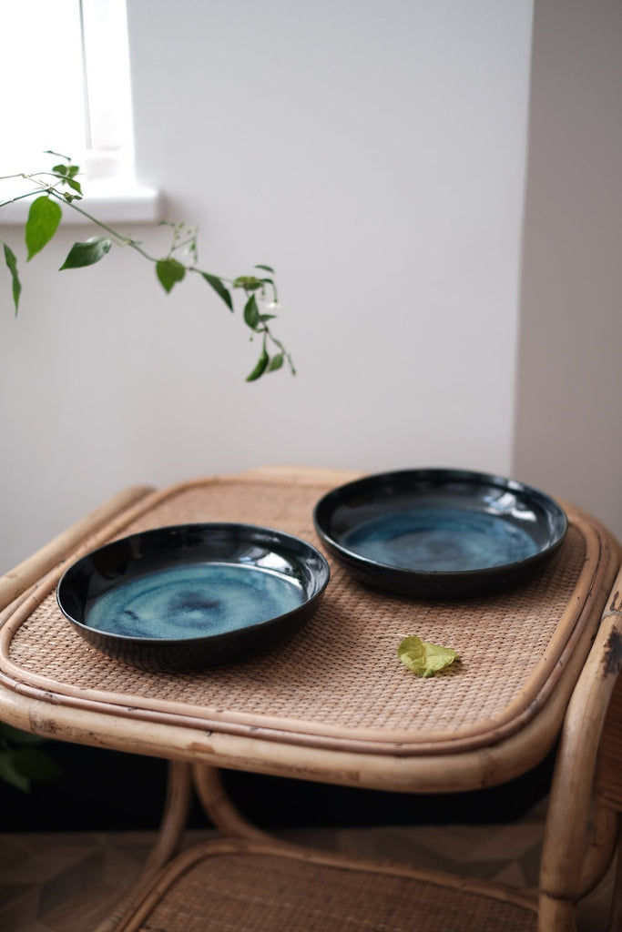 two shallow ceramic bowls, with ocean blue and green effect glazing