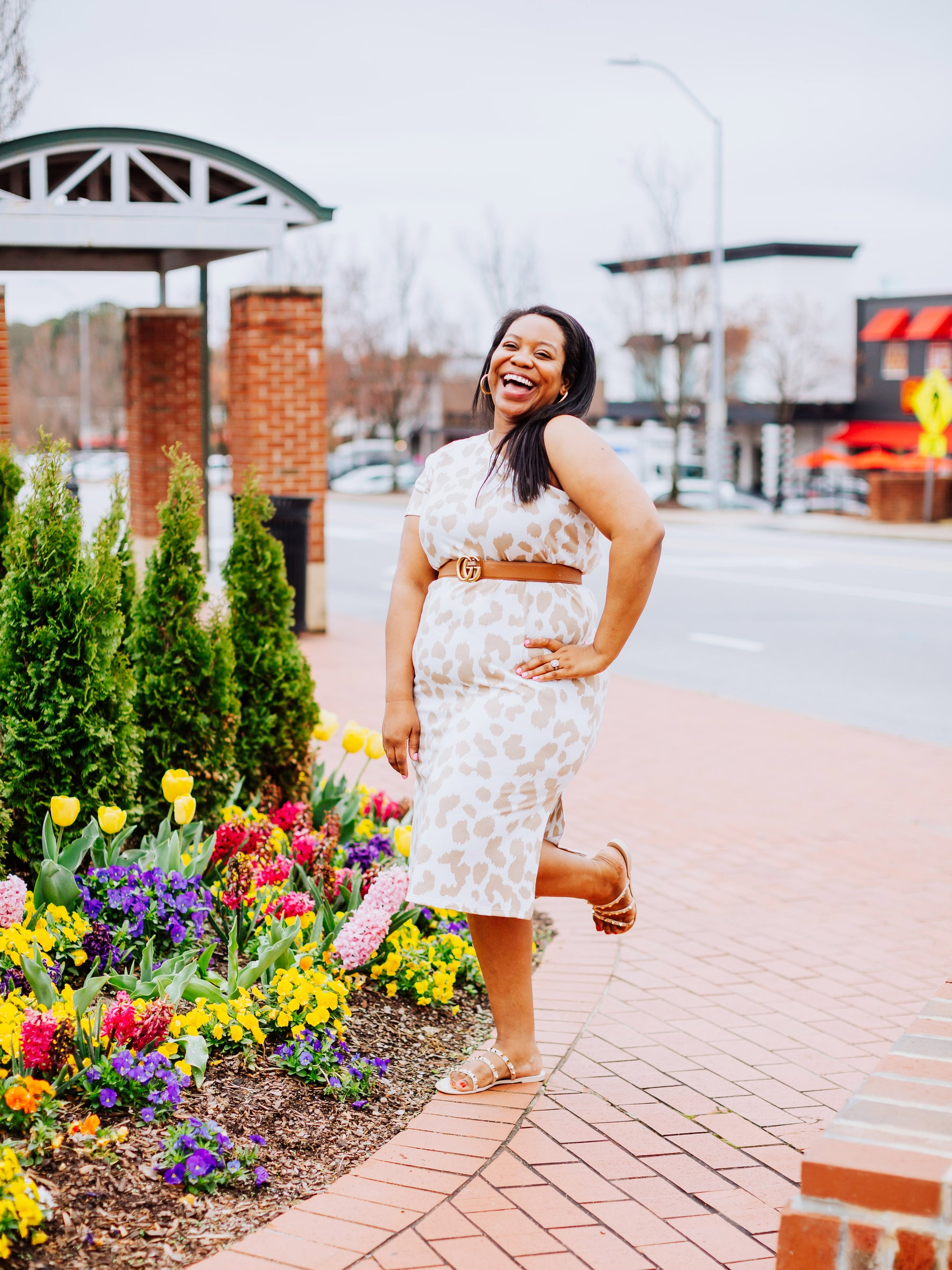 Photo of Chelsea, the owner of CharleyMadelyn, smiling and wearing a leopard print dress