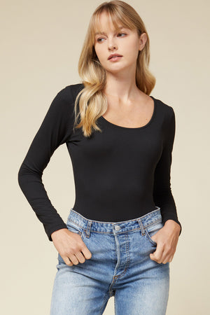 Front View of Black Scoop Neck Long Sleeve Bodysuit Paired With Blue Jeans