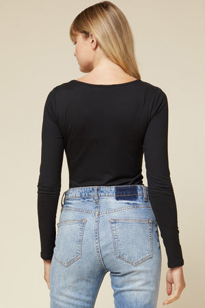 Back View of Black Scoop Neck Long Sleeve Bodysuit Paired With Blue Jeans