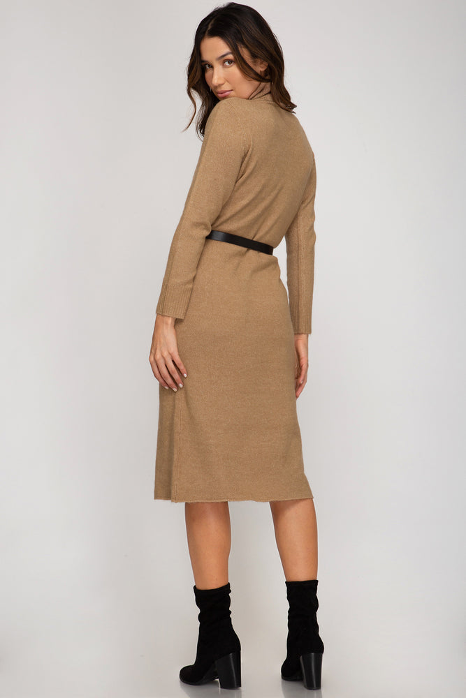 Back View of Tan Long-sleeve Turtleneck, 3/4 Length Sweater Dress Paired with Black and Gold Belt and Black Suede Boots