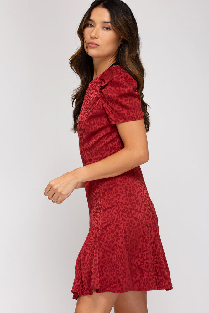 Up Close Image of Red Puff Sleeve On Dress with Leopard Print Detailing