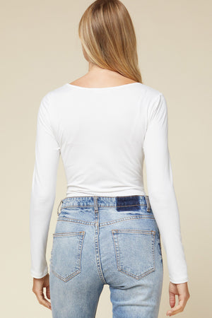 Back View of White Scoop Neck Long Sleeve Bodysuit Paired with Blue Jeans