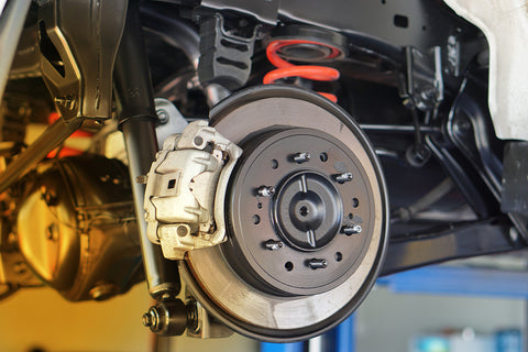 Innova Electronics, brakes on a car getting inspection by mechanic
