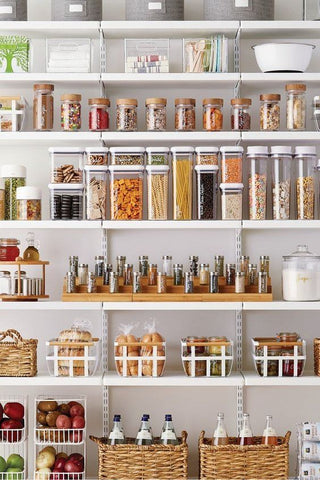 Tidy pantry of food with everything packaged in containers.