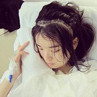 Hiro, founder of Burgundy for Life, with staples across her head after brain surgery