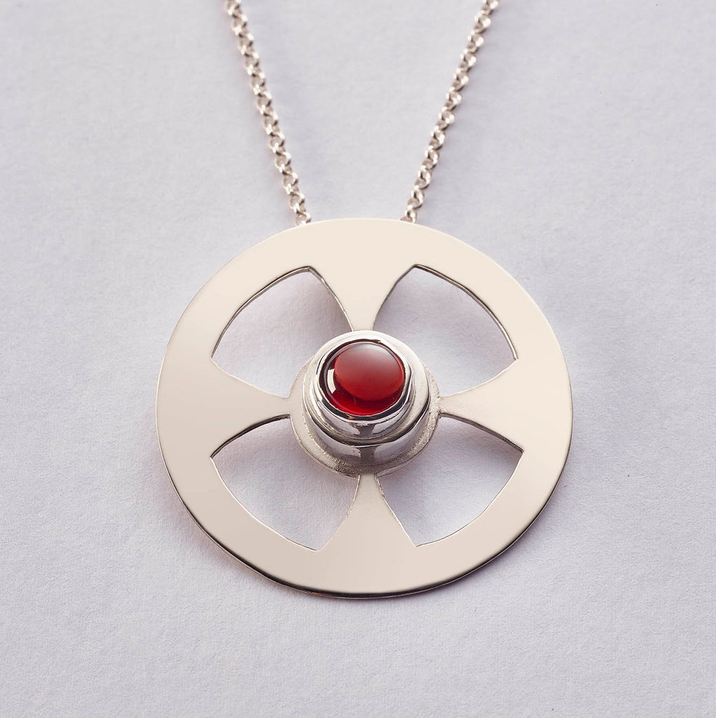 Celtic Contemporary Cross in sterling with Garnet