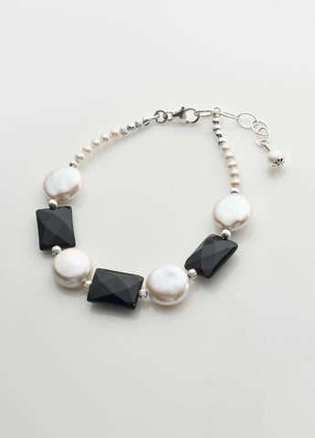 Freshwater pearl coin and faceted black onyx bracelet with sterling silver