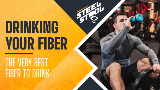 Man Working Out and Drinking Out of Bottle